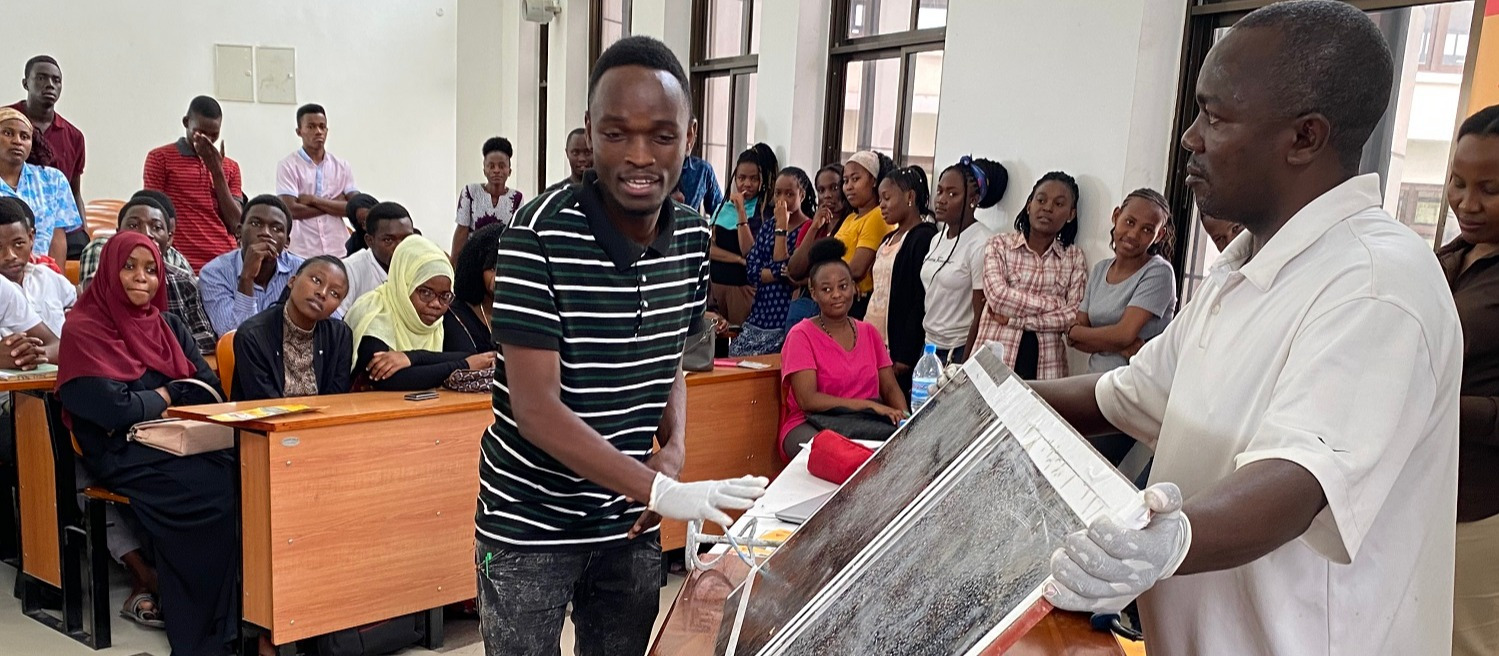 The Ardhi University first year students taking  Bachelor of Science in Building Economics during their practical training on preparation of the Epoxy Floor from an expert from Sika Tanzania.