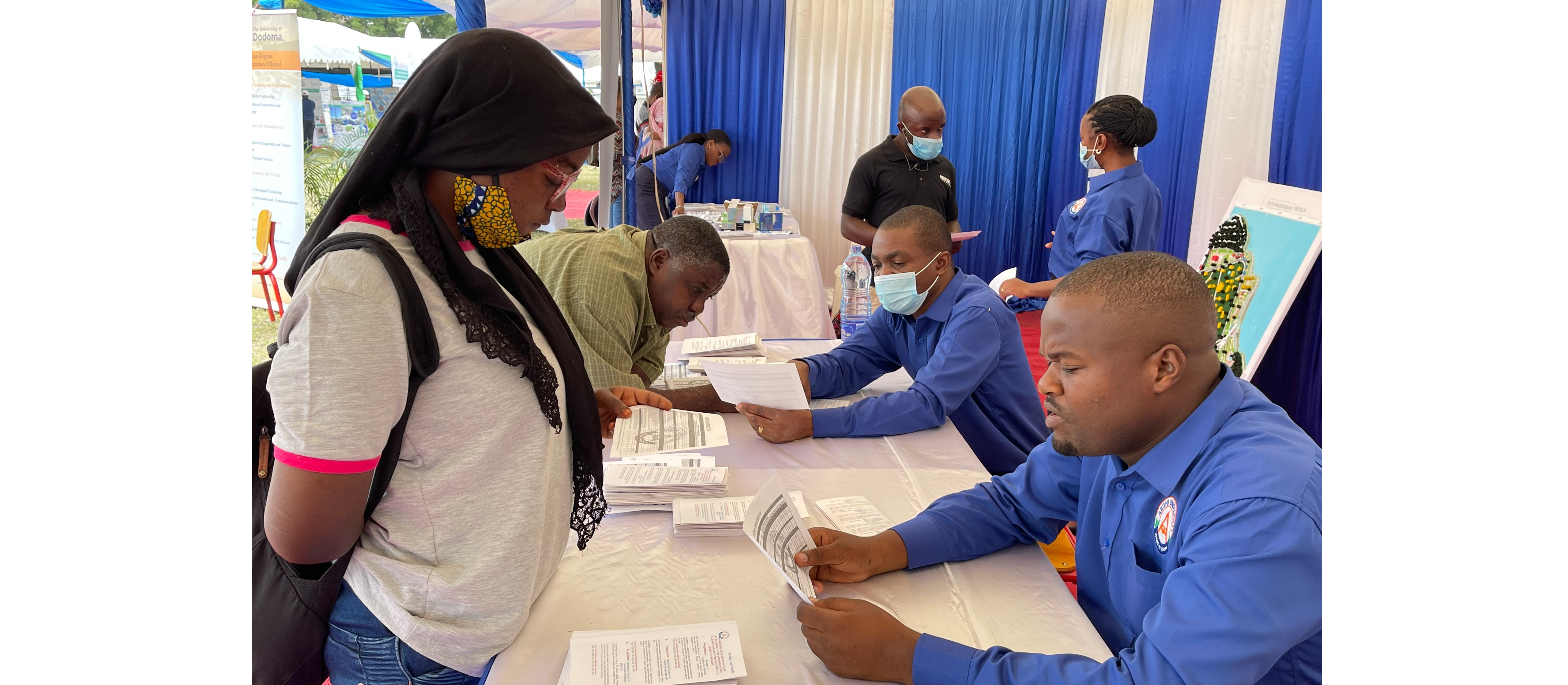 University staff providing assistance to applicants of the Academic programmes during TCU exhibition at Mnazi Mmoja ground