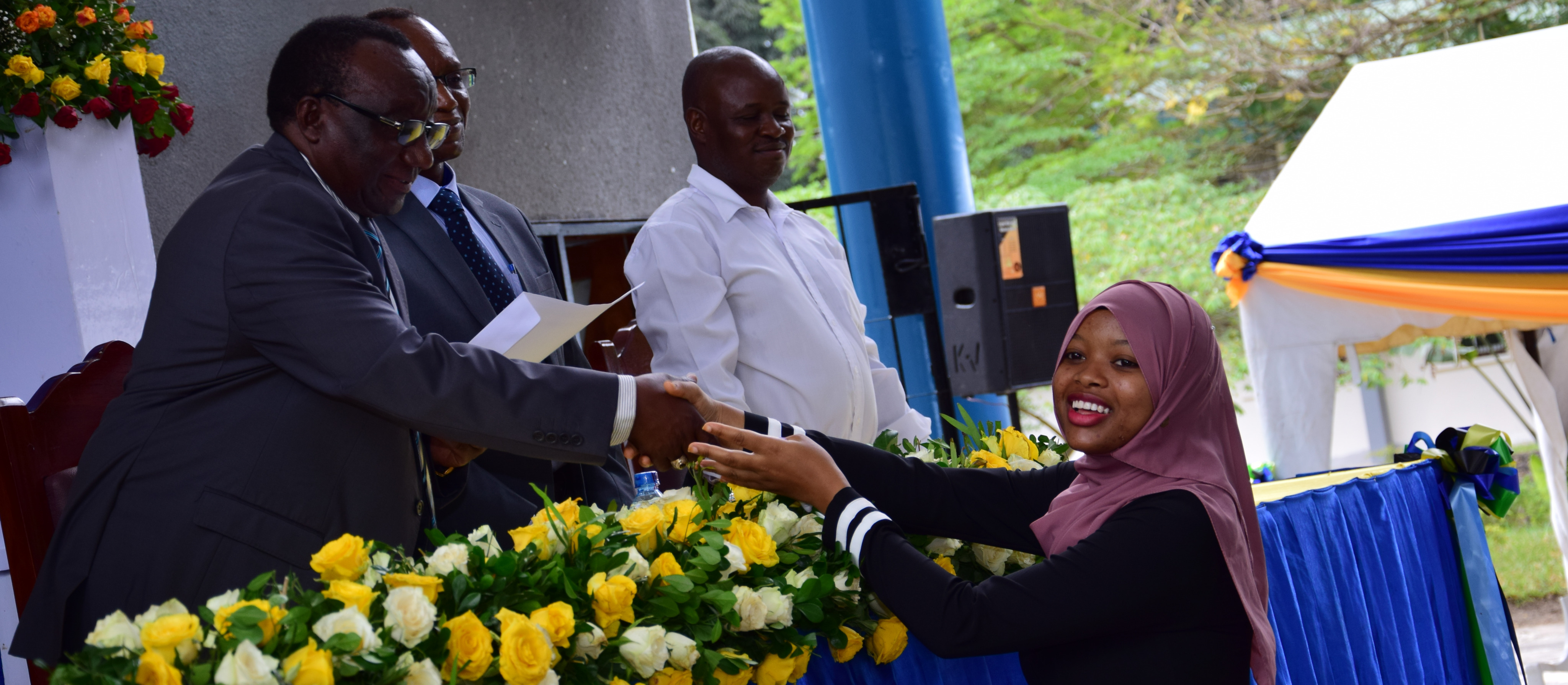 Ms Jasmine Mndeme, the overall best student for the year 2019/2020 receiving an award from the Ardhi University Vice Chancellor, Prof. Evaristo Liwa, during the prize awarding ceremony held at the University in December, 2020